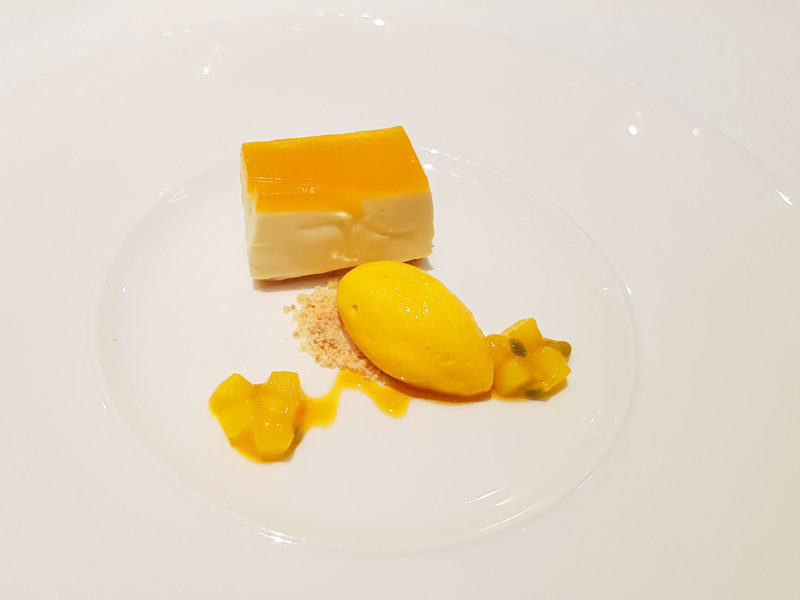 White chocolate cheesecake with passionfruit and mango sorbet