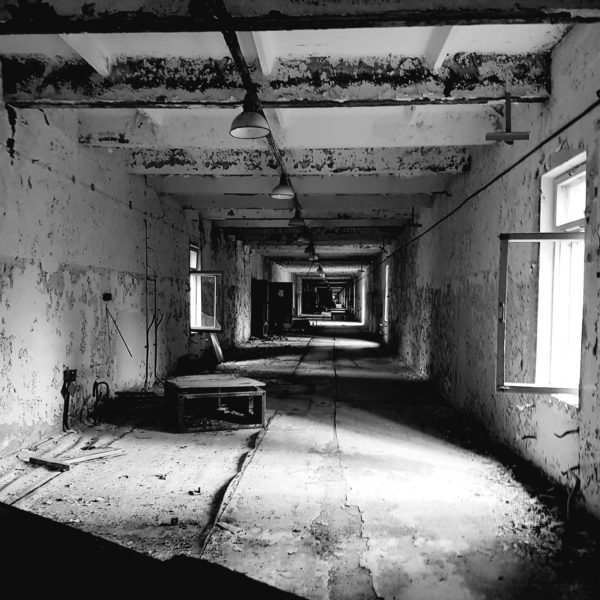 black and white photo chernobyl building corridor