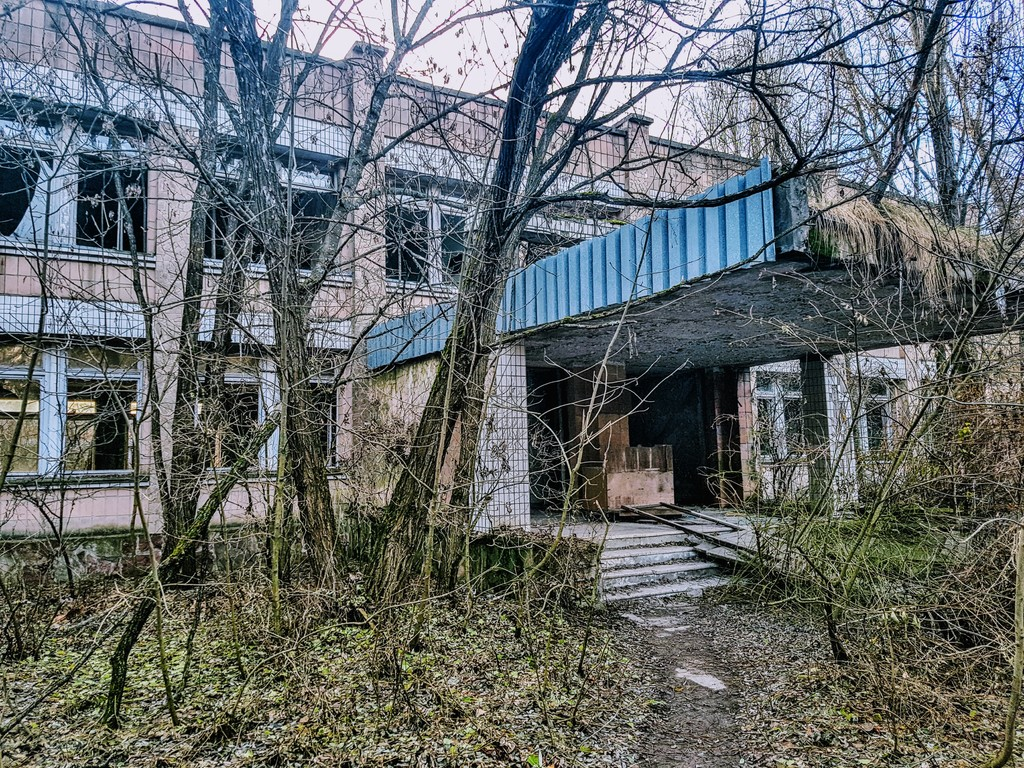 exploring the chernobyl exclusion zone day pripyat roaming abandoned building overgrown trees