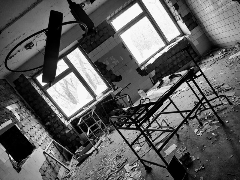 Black and white photo of abandoned hospital room in Chernobyl